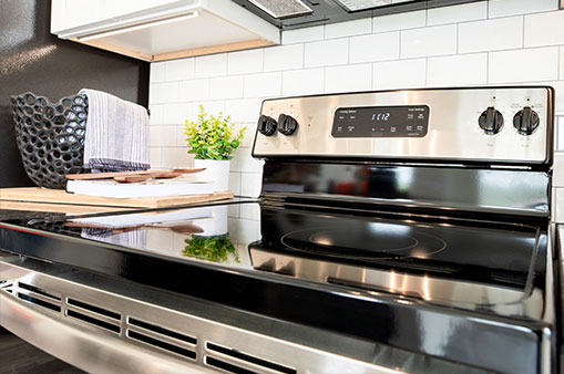 close up of stainless steel oven in kitchen at Dartmoor Place at Oxford Square apartments in Hanover MD